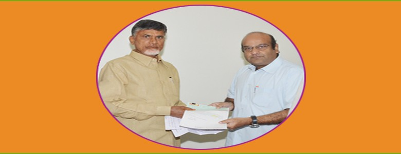 "Sri K V Vishnu Raju, Chairman, Sri Vishnu Educational Society, donating a Cheque of Rs. 25,00,000 /- to Chief Minister, Sri N. Chandrababu Naidu, to CM Relief Fund towards ""HudHud Cyclone Victims""."